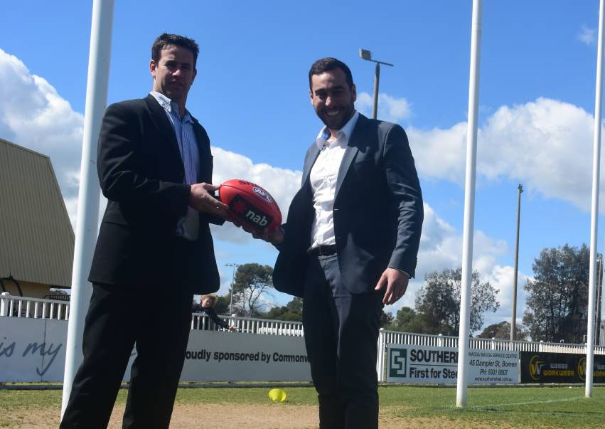 Southern NSW AFL regional manager Jason McPherson and AFL NSW's Joseph La Posta celebrate the partnership.