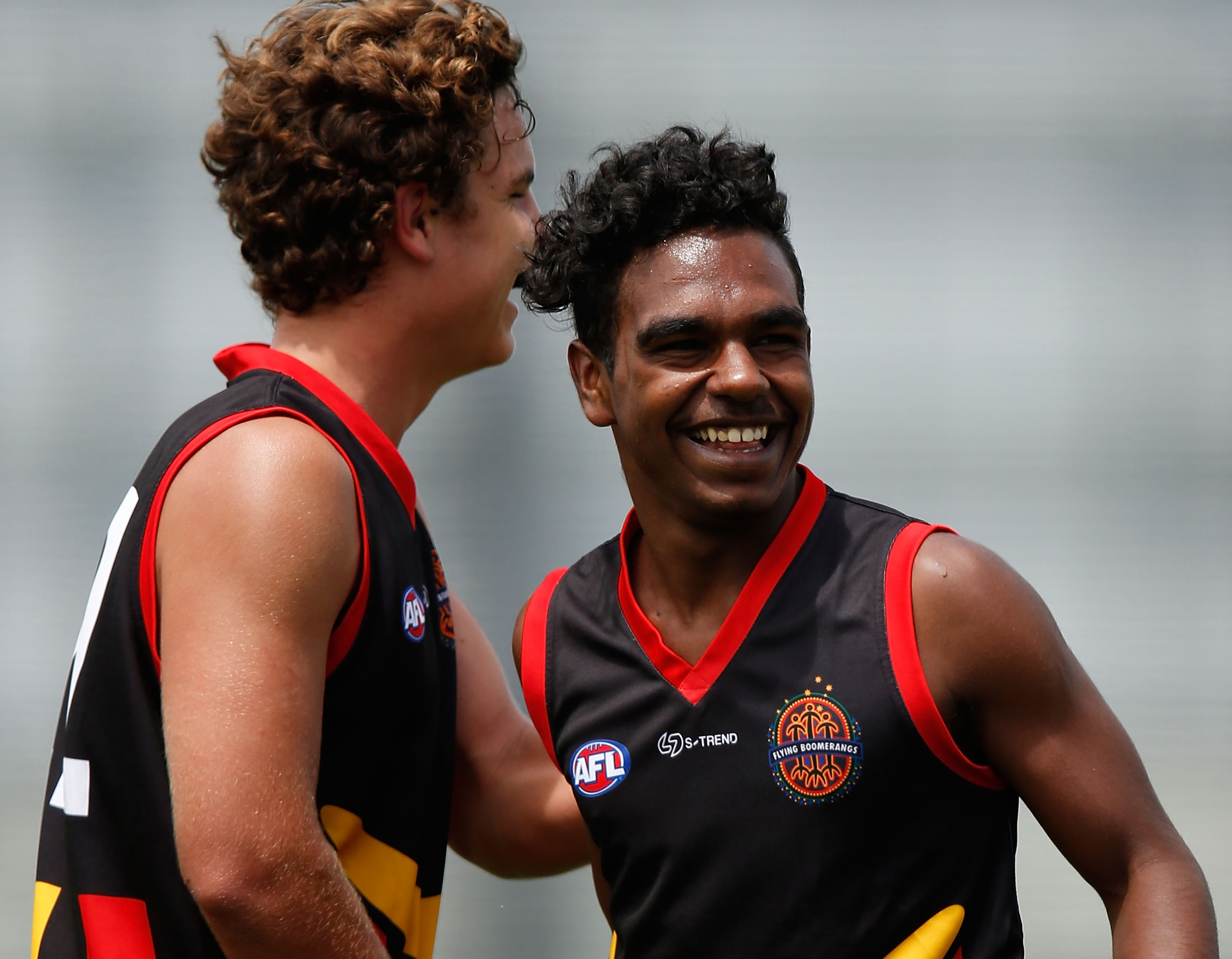 Shaydan Close (right) celebrates kicking one of his four goals. (Photo: Michael Willson/AFL Media)