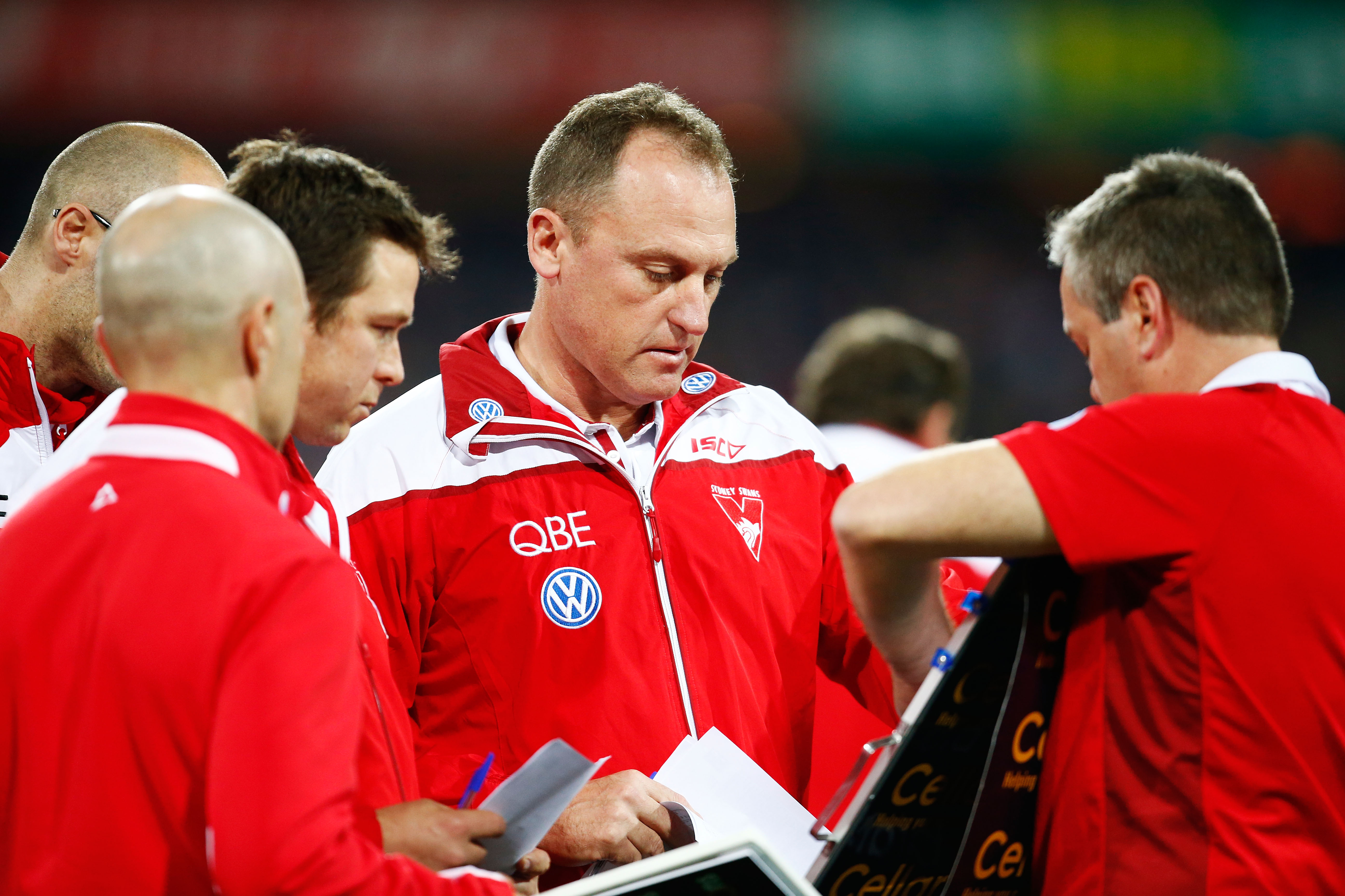 Swans head coach John Longmire talks tactics with other coaches during the 2015 AFL round thirteen match . (Photo by Matt King/AFL Media)