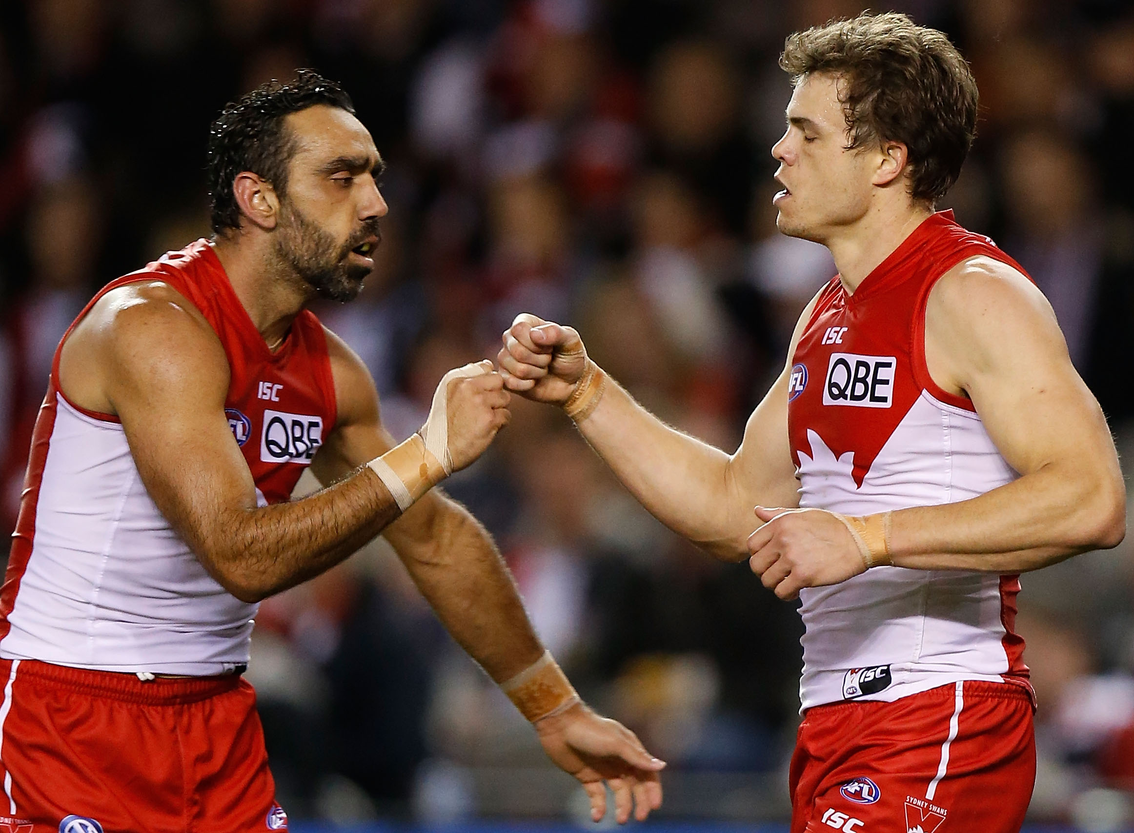 MELBOURNE, AUSTRALIA - AUGUST 30: Adam Goodes (left) and Mike Pyke of the Swans celebrate during the 2015 AFL round 22 match between the St Kilda Saints and the Sydney Swans at Etihad Stadium, Melbourne, Australia on August 30, 2015. (Photo by Michael Willson/AFL Media)