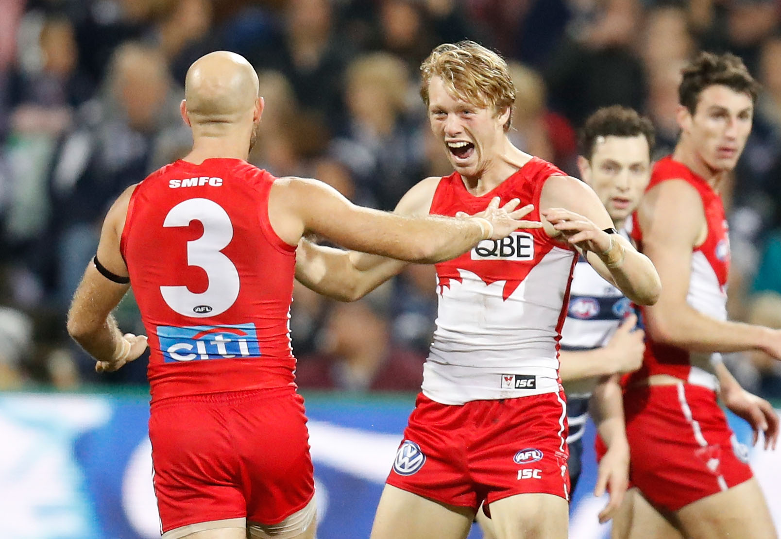 Jarrad McVeigh (left) and Callum Mills of the Swans celebrate during the 2016 AFL Round 16 match between the Geelong Cats and the Sydney Swans at Simonds Stadium on July 8, 2016 in Geelong, Australia. (Photo by Michael Willson/AFL Media)
