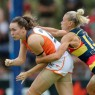 ADELAIDE, AUSTRALIA - FEBRUARY 4: Erin McKinnon of the Giants tackled by Erin Phillips of the Crows during the 2017 AFLW Round 01 match between the Adelaide Crows and the GWS Giants at Thebarton Oval on February 4, 2017 in Adelaide, Australia. (Photo by AFL Media)